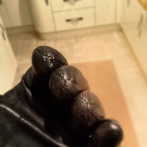 Modified leather gloves with conductive stitching
